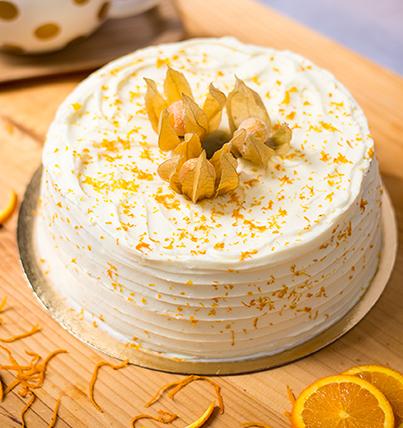<b>Tarta angel de naranja </b> <br>con cobertura de queso